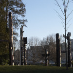 The Totem Poles with Downtown Vancouver in background